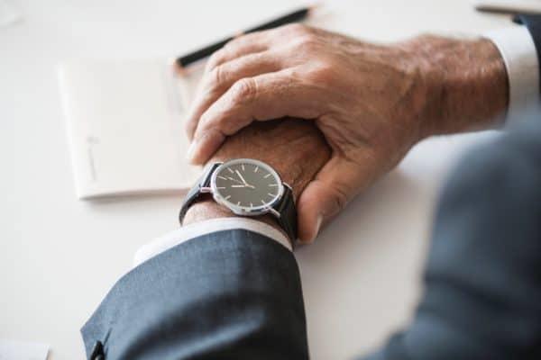 man checking his watch