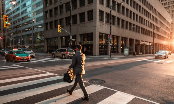 business man crossing street