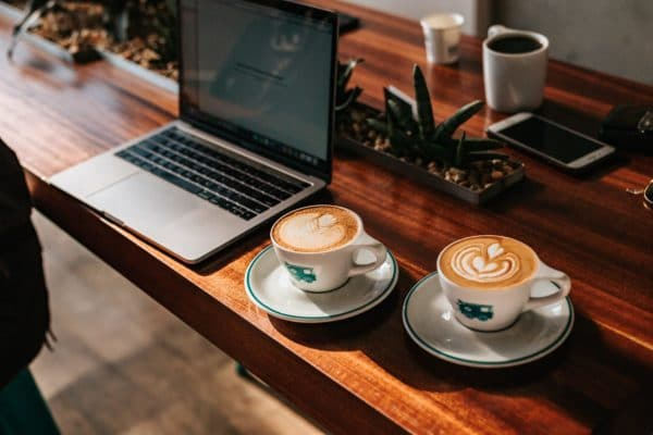 working remotely in coffee shop